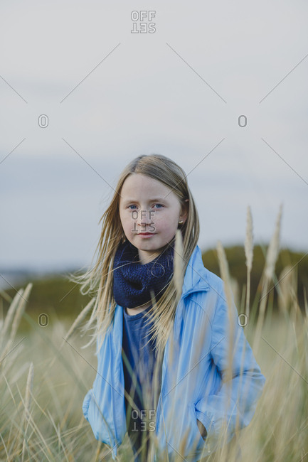 A young girl outside in the long grass
