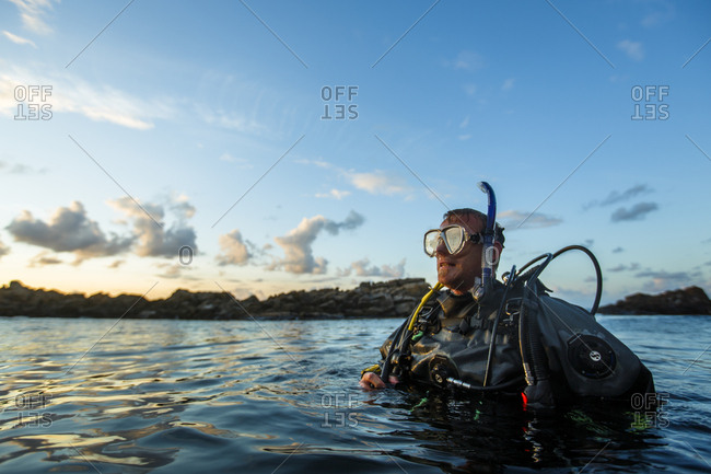 Skane, Sweden - August 14, 2014: A man SCUBA diving