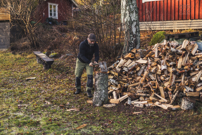 A man splitting fire wood