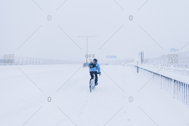 Man cycling in snow in Sodermalm