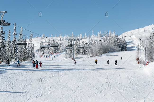 Harjedalen, Sweden - March 7, 2017: Wide angle view of people skiing