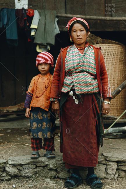 Langtang, Nepal - November 5, 2011: Tamang woman and her child in village