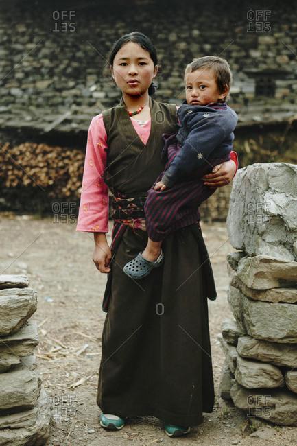 Langtang, Nepal - November 5, 2011: Young Tamang mother holding her child