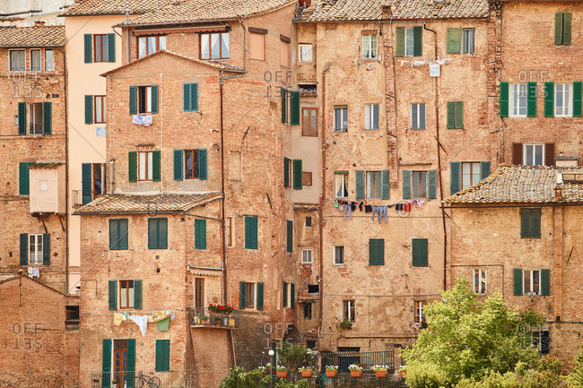 Full frame view of densely packed housing in Siena, Italy