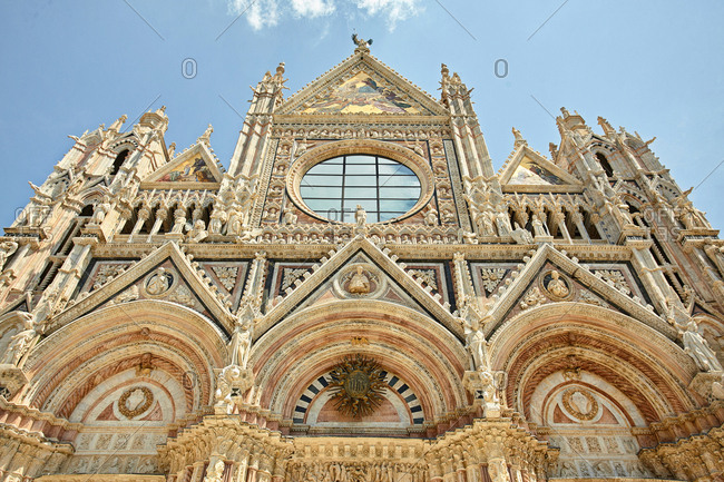 Looking up at the ornate facade of the Cathedral in Siena, Italy