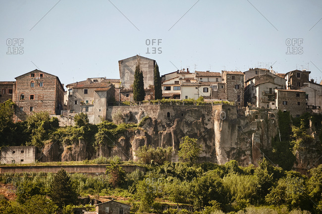 Looking up at densely packed houses of hilltop village in Italy