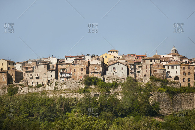 View of densely packed houses of hilltop town in Italy