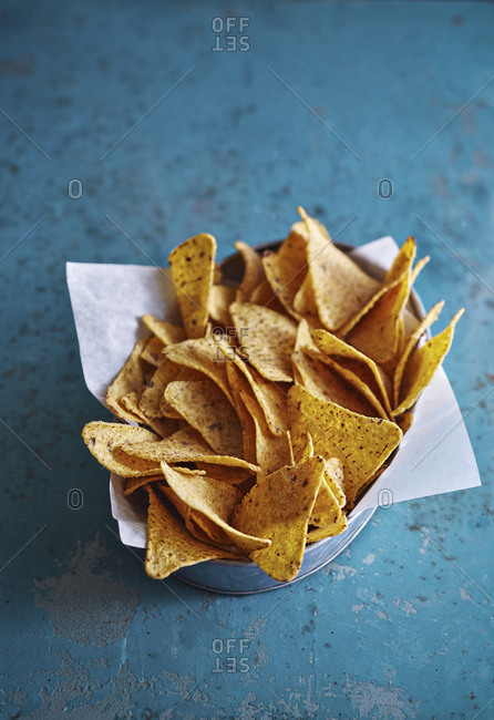 High angle view of tortilla chips in metal container