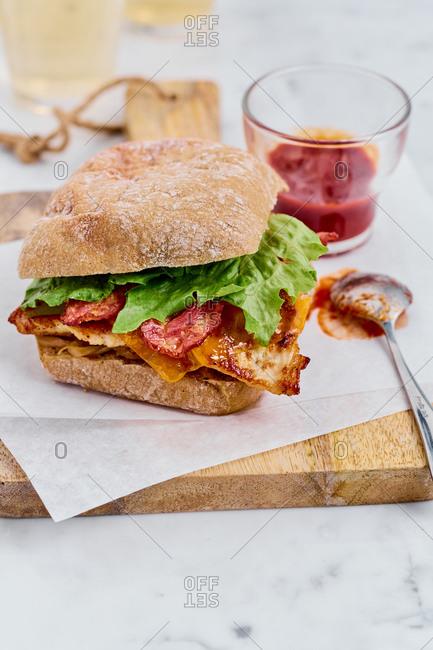 Appetizing chicken, bacon, cheese sandwich on whole-wheat ciabatta