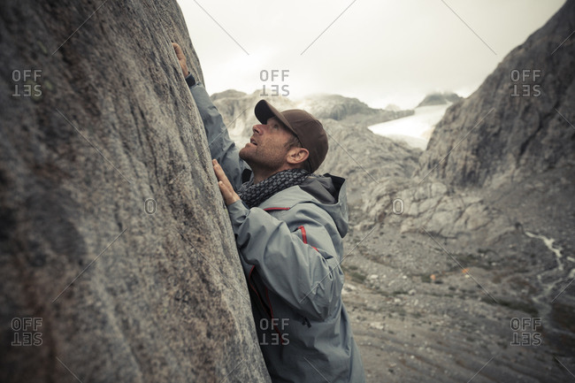 Side view of rock climber by mountain at Garibaldi Provincial Park