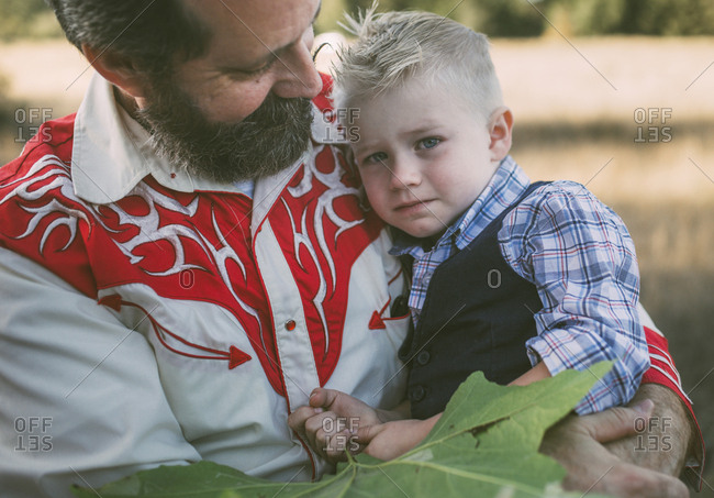 Portrait of worried grandson with grandfather at park