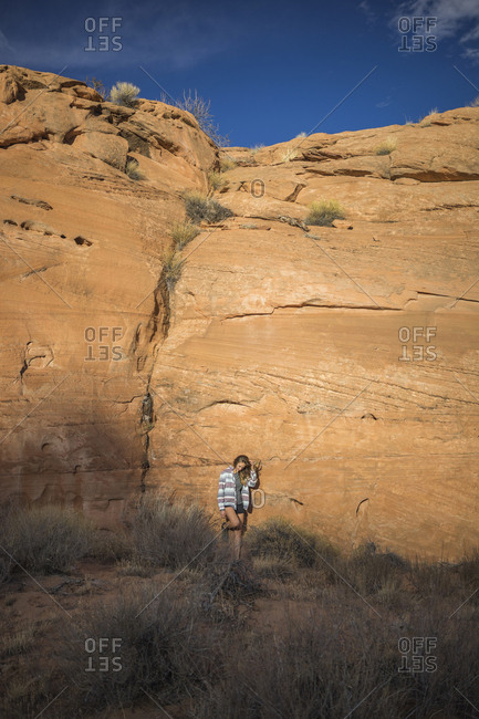 Full length of woman standing against rock formations