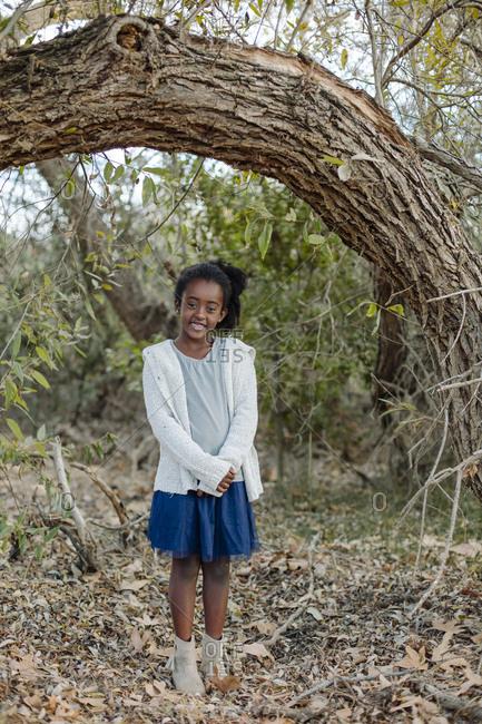 Full length portrait of girl standing on field at park
