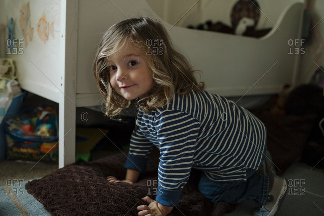 Portrait of cute girl playing at home