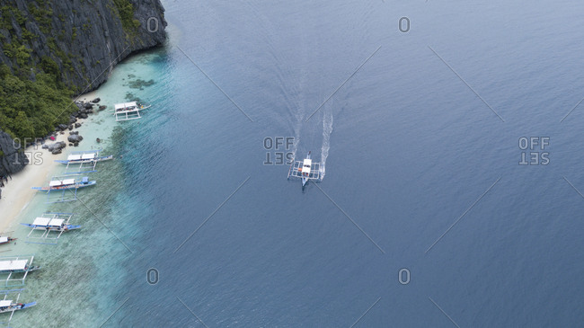 High angle view of outrigger boat in sea