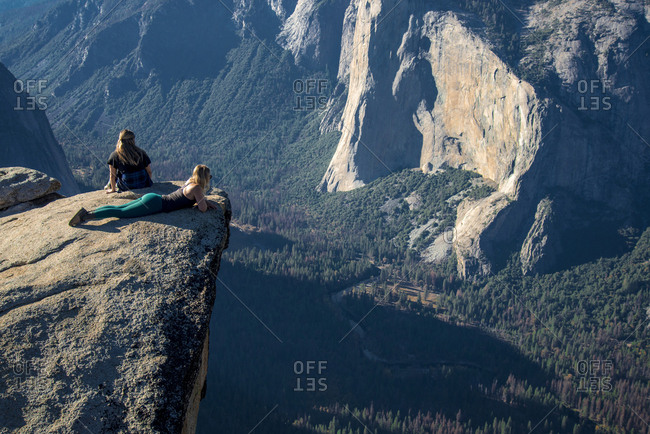 High angle view of female friends relaxing on cliff at Yosemite National Park