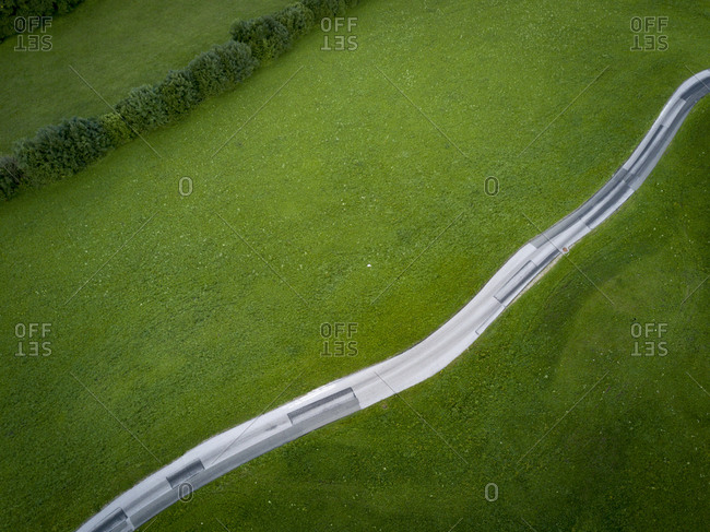 High angle view of road by grassy field