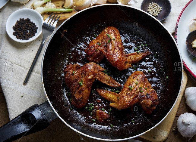 High angle view of chicken meat in cooking pan on table