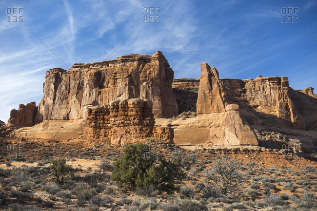Scenic view of rock formations at Arches National Park against blue sky during sunny day