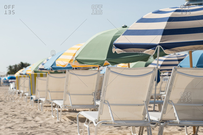 Lounge chairs and umbrellas on a beach in Miami, Florida