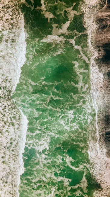 Aerial view of a volcanic wild beach