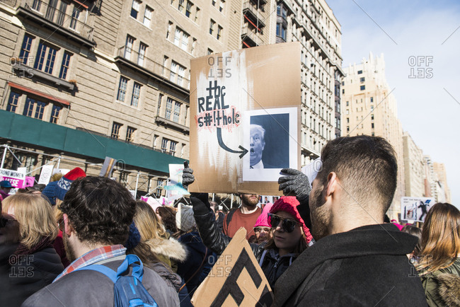 New York City, New York, USA - January 20, 2018: Person holding sign among crowd at Women's March