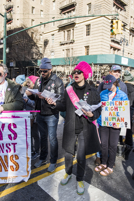 New York City, New York, USA - January 20, 2018: Activists passing out flyers and carrying signs at Women's March
