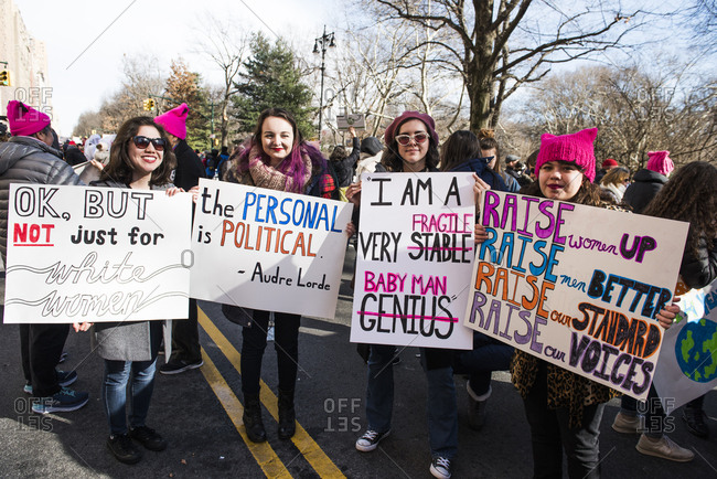 New York City, New York, USA - January 20, 2018: Group of young women carrying signs at Women's March