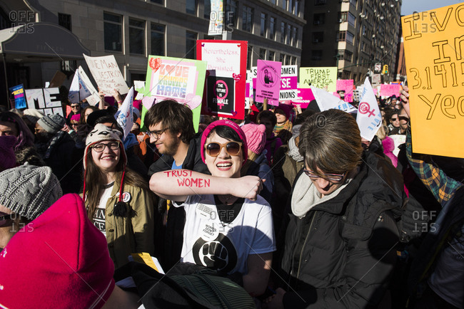 New York City, New York, USA - January 20, 2018: Smiling women among crowd at Women's March