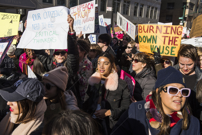 New York City, New York, USA - January 20, 2018: People standing among crowd of demonstrators at Women's March