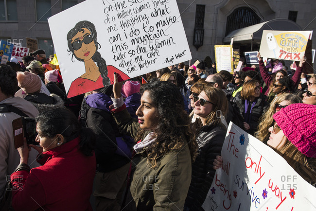 New York City, New York, USA - January 20, 2018: Woman carrying sign among crowd of demonstrators at Women's March