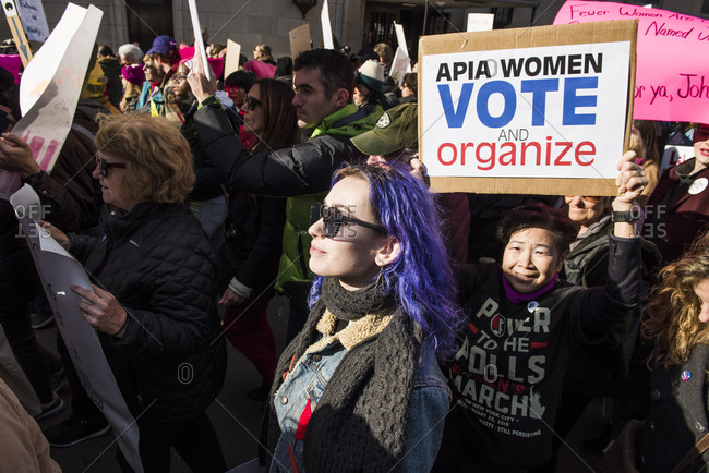 New York City, New York, USA - January 20, 2018: Woman holding sign among crowd of demonstrators at Women's March