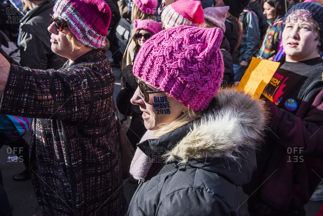 New York City, New York, USA - January 20, 2018: Woman wearing pink hat at Women's March