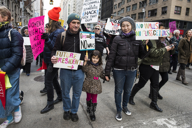 New York City, New York, USA - January 20, 2018: Family holding signs at Women's March