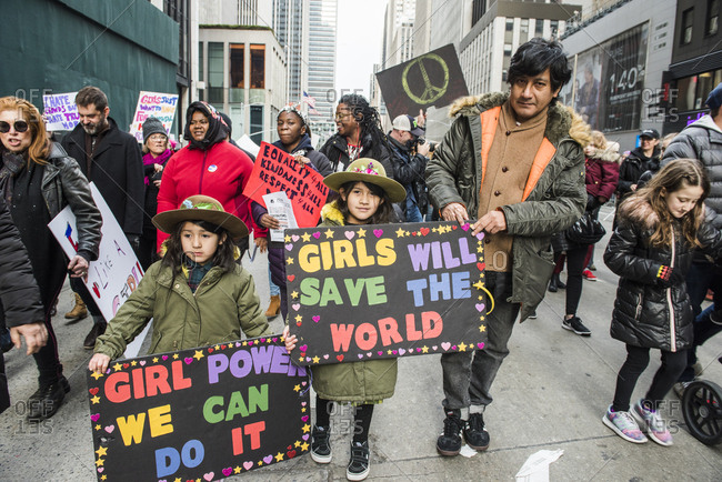 New York City, New York, USA - January 20, 2018: Girls holding signs at Women's March