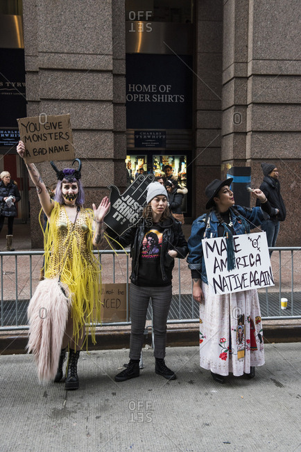 New York City, New York, USA - January 20, 2018: Women in costume holding signs at Women's March