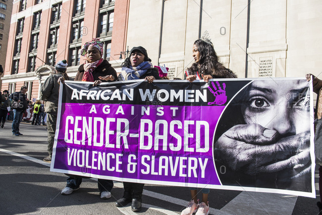 New York City, New York, USA - January 20, 2018: Women carrying banner at Women's March