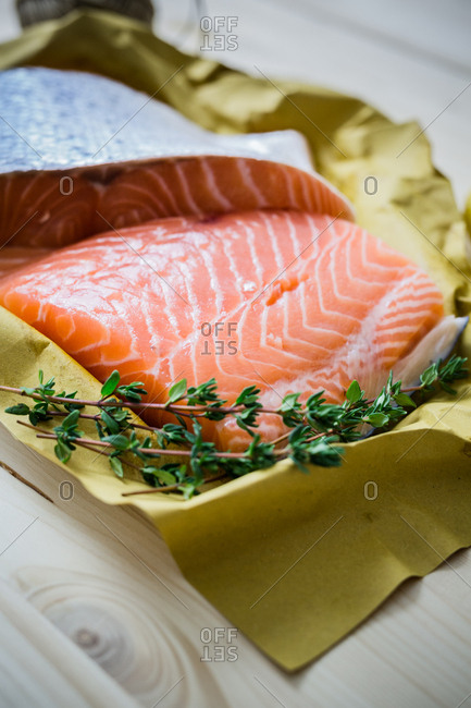 Tray of raw salmon with paper setting