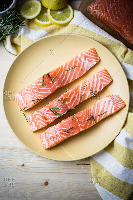 Three strip raw salmon serving