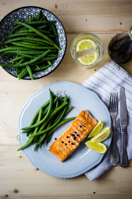 Roasted salmon dinner spread with extra vegetables