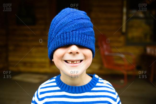 Boy wearing blue knit hat