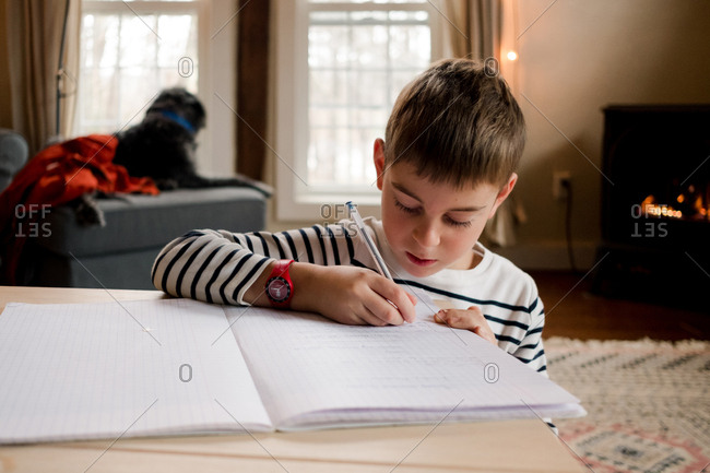 Young boy learning to write