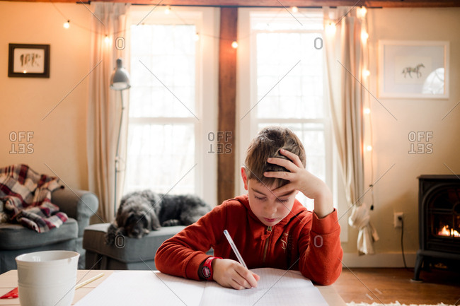 School aged boy learning to write