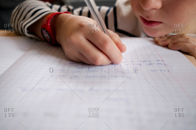 Close up of a young boy learning to write