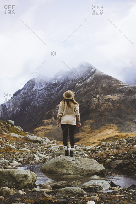 Woman staring out at the freshly snow capped mountain tops