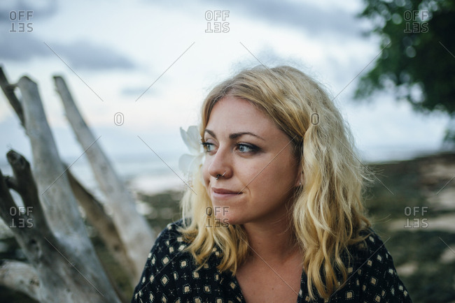 Portrait of young woman with nose piercings