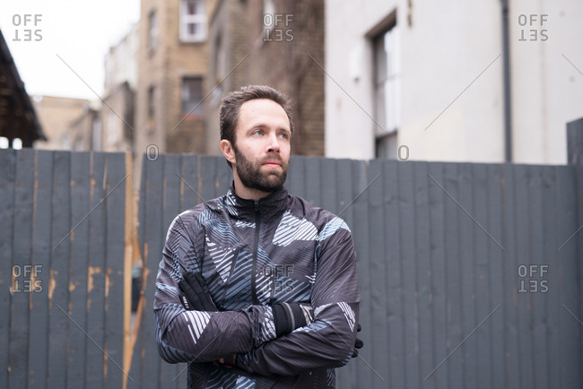 Runner waiting in cold with arms crossed