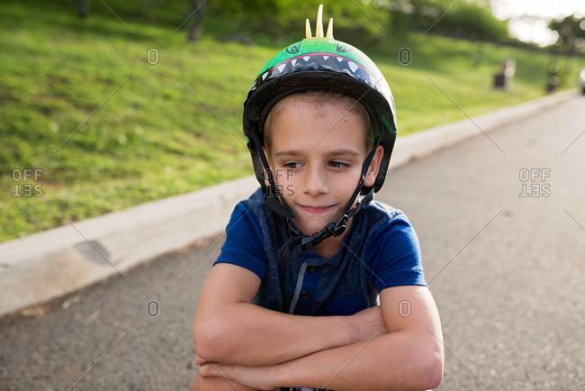 Portrait of boy wearing a spiky helmet