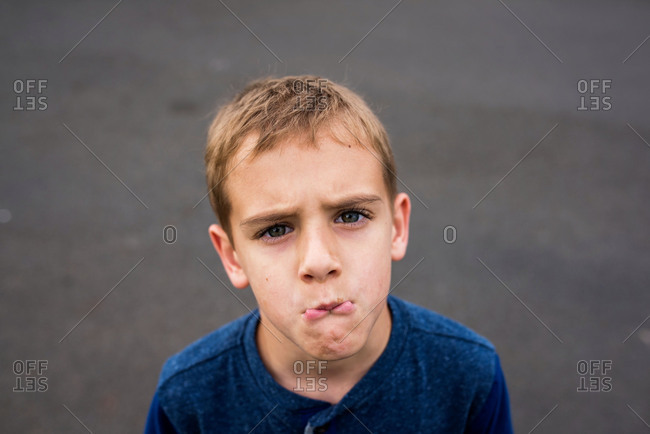 Portrait of boy wearing making pout with his lips
