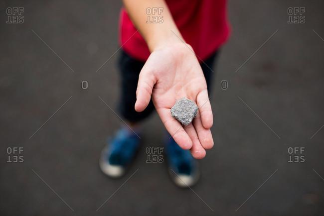 Boy holding rock